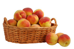 Peach in basket. Basket full of fresh peaches isolated on white background Royalty Free Stock Photo