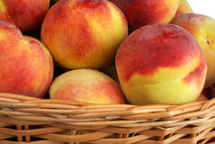 Peach in basket Stock Images