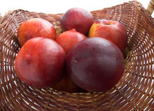 Peach in a basket Royalty Free Stock Image