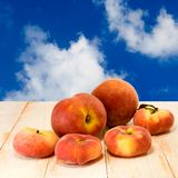 Peach on blue sky background Royalty Free Stock Image