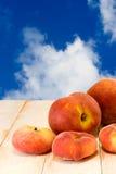 Peach on blue sky background Stock Photography
