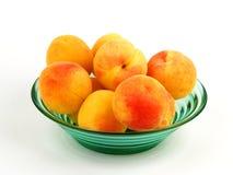 Peach in a bowl Stock Photos