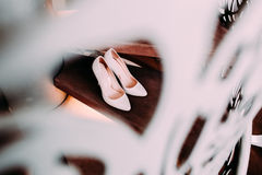 Peach bridal wedding shoes on wooden stairs with decorative railings. Top view Royalty Free Stock Images