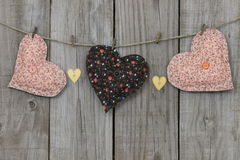 Peach and brown hearts hanging on clothesline Royalty Free Stock Image