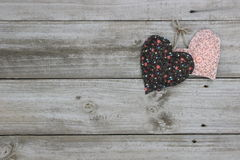Peach and brown hearts hanging on rope Stock Photo