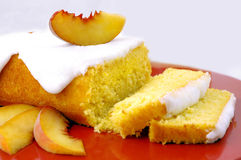 Peach Cake. With icing and fresh peach garnish Royalty Free Stock Image