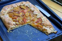 Peach Cake. In baking pan with knife. Selective focus Stock Photos