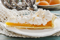 Peach cake with meringue topping. Party dessert Stock Photo