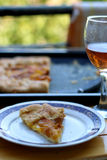 Peach Cake. Slice of peach cake and glass of red wine outdoor. Selective focus Stock Photography