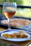 Peach Cake. Slice of peach cake and glass of red wine outdoor. Selective focus Stock Photo