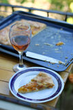 Peach Cake. Slice of peach cake and glass of red wine outdoor. Selective focus Royalty Free Stock Photo