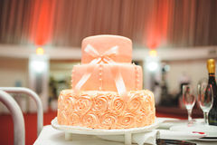 Peach Cake. Wedding peach cake with elegant bow Royalty Free Stock Photography