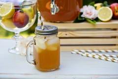 Peach cardamom lemonade with ice cubes Royalty Free Stock Photography
