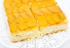 Peach cheese cake. Fresh peach cheese cake - closeup shot Royalty Free Stock Photography