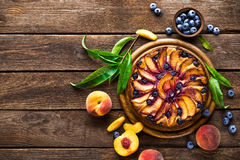 Peach cheese cake or pie with fresh blueberry on wooden rustic background, top view Royalty Free Stock Photography