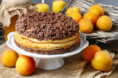 Peach cheesecake with chocolate topping Royalty Free Stock Photography