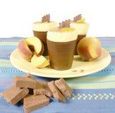 Peach chocolate desert Stock Images