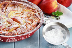 Peach Clafouti with Powered Sugar Stock Photo