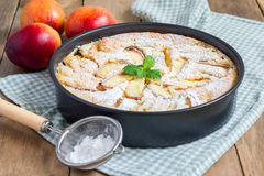 Peach clafoutis in a baking dish Stock Photos