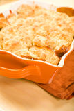 Peach Cobbler. Pan of Peach cobbler fresh from the oven royalty free stock images