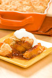 Peach cobbler. Served with whipped cream royalty free stock images