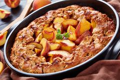 Peach Cobbler a deep-dish fruit dessert. Good for the breakfast, cooked in advance meal, close up royalty free stock image