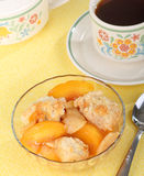 Peach Cobbler Dessert. Bowl of peach cobbler and a cup of coffee stock photos