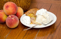 Peach cobbler with ice cream Stock Photos