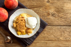 Peach cobbler with ice cream Royalty Free Stock Image