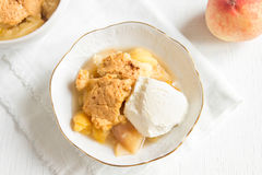 Peach cobbler with ice cream Royalty Free Stock Images