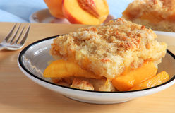 Peach cobbler. Southern United States treat overflowing with fresh summer fruit royalty free stock photos