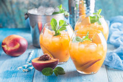 Peach cocktail or tea Royalty Free Stock Photos