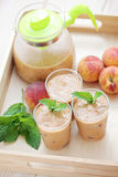 Peach coctail. Delicious and cold peach coctail - food and drink Royalty Free Stock Image