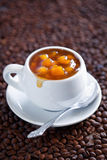 Peach coffee jam. In coffee cup, selective focus Stock Photo