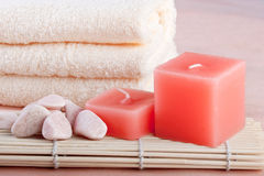 Peach color spa setting. With red candles Stock Images