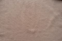 Peach colored plain polyester fabric. From above Royalty Free Stock Images