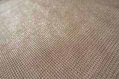 Peach colored polyester fabric with sparkles. Peach colored plain polyester fabric with sparkles Royalty Free Stock Photography