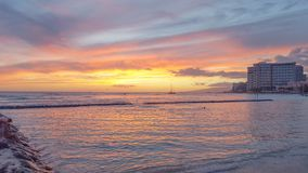 Free Peach Colored Sunset Reflected On The Water At Waikiki Beach Royalty Free Stock Images - 147780179