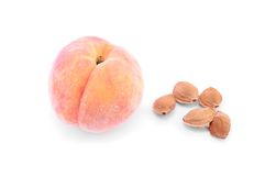 Peach with core isolated on white Royalty Free Stock Photography