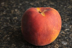 Peach on Countertop Stock Photography