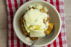 Peach Crisp. Homemade peach crisp in a white bowl and spoon Royalty Free Stock Image