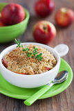 Peach crumble. Peach and thyme oatmeal crumble, selective focus Royalty Free Stock Photos