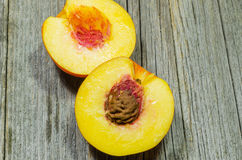Peach cut in half Royalty Free Stock Photos
