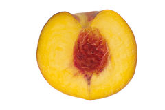 Peach cut through and isolated in white. A peach cut in half and isolated in white background Stock Images