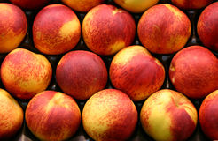 Peach display. Colored peach display on the market Stock Image