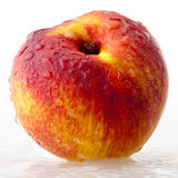 Peach in droplets of water Royalty Free Stock Photo