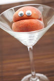 Peach with eyes Stock Photos