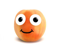 Peach with face Royalty Free Stock Photo