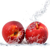 Peach falling in water Stock Photo