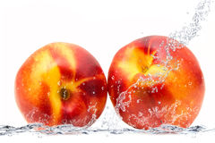 Peach falling in water Stock Image